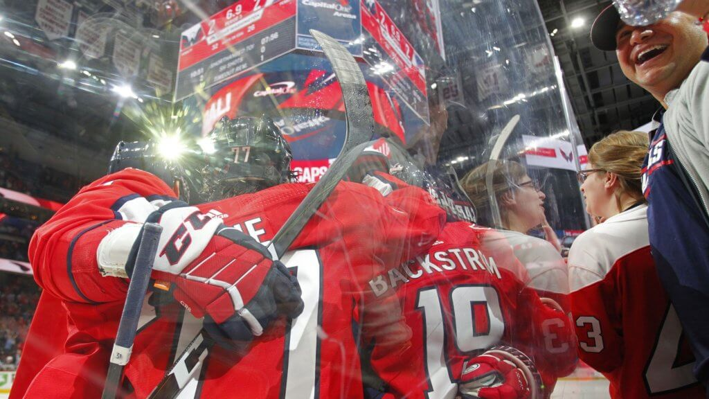 Washington Capitals center Nicklas Backstrom (19) celebrates with teammates scoring the game winning goal in the final seconds of the third period against the St. Louis Blues at Capital One Arena.